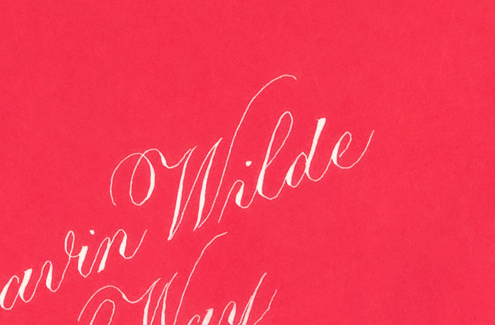 The surname of Wilde, white ink on a red envelope.