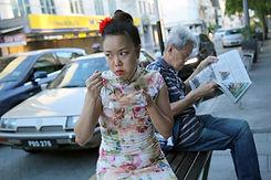 Vera eating in Penang street GRADED.jpg