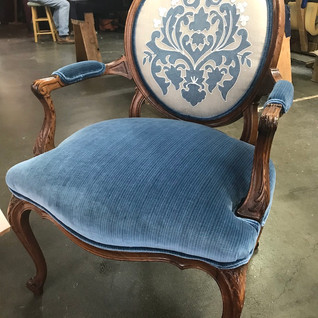 This gorgeous chair was reupholstered using fabrics found in our shop !