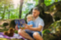 photo-of-man-and-child-reading-book-duri