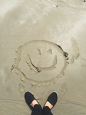 smiley-drawing-on-sand-698899.jpg