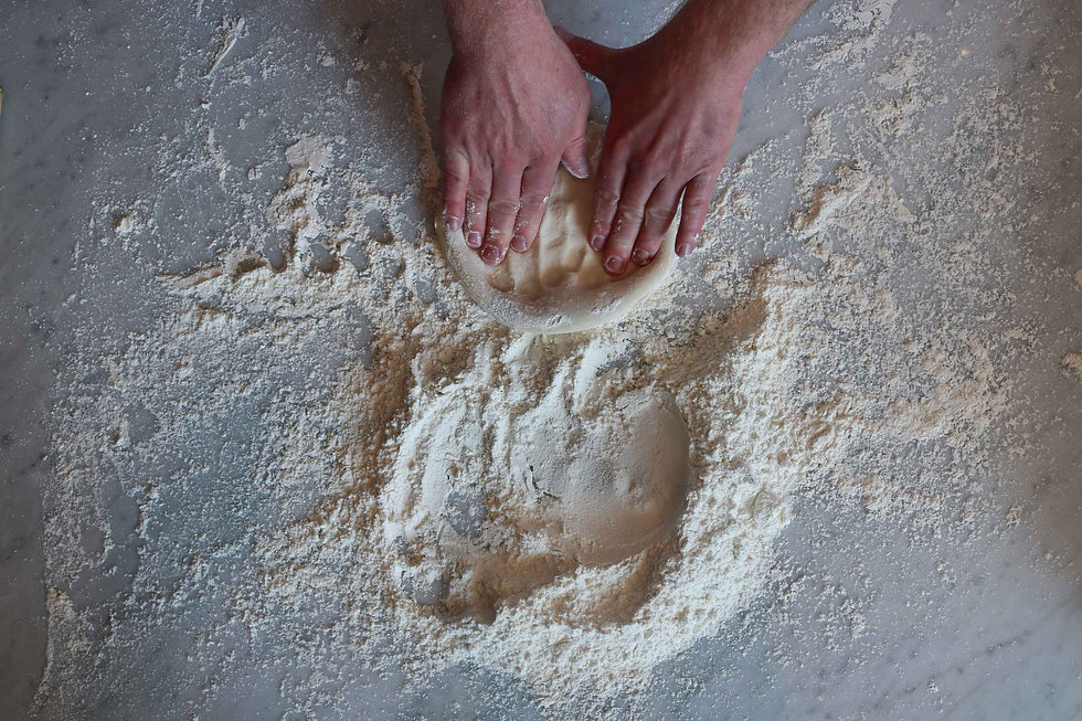 hands-making-pizza-dough-at-800-degrees.