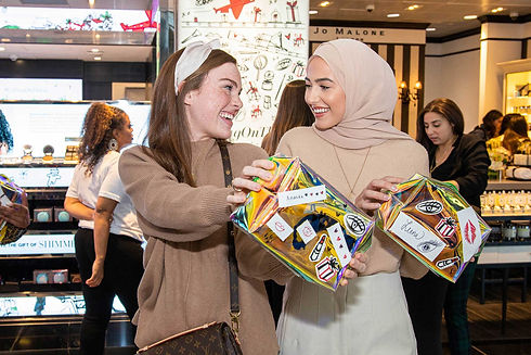two-young-women-with-promotional-travel-