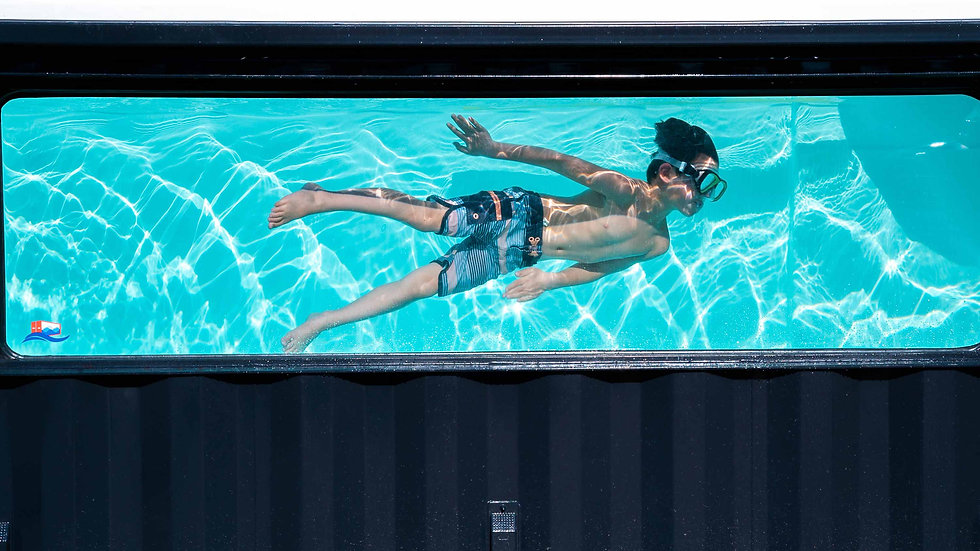 Little boy swimming in a ContainUR Pools shipping container pool