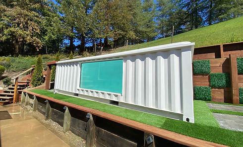 ContainUR Pools shipping container pool installed on a berm