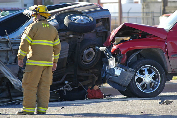 Fireman working a car accident scene