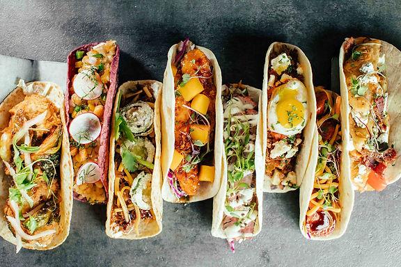 lineup-of-tacos-at-velvet-taco.jpg