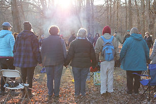 group-of-people-in-woods-holding-hands-i