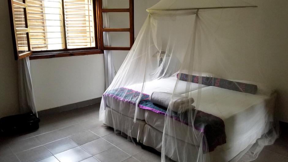 lola-ya-bonobo-bed-with-mosquito-netting