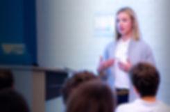 female-speaker-addressing-group-at-ventu