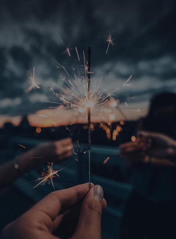 hands-holding-a-lit-sparkler.jpg