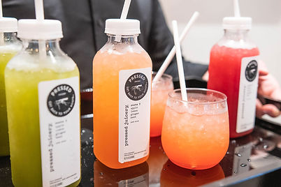 multiple-flavors-of-pressed-juicery-drinks-sitting-on-a-table