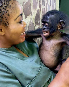 surrogate-mother-smiling-and-holding-baby-bonobo