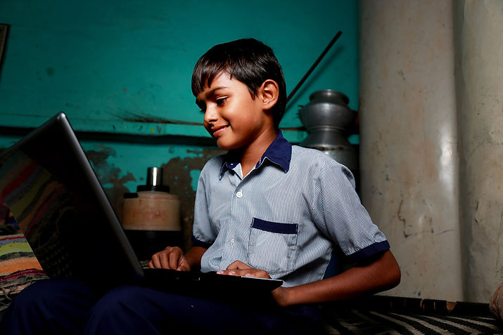 young-indian-student-working-at-home-on-