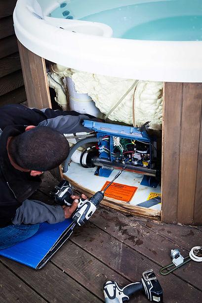 spa-repairman-working-on-interior-of-jac