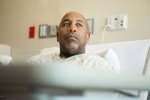 Thoughtful African-American man in hospital bed