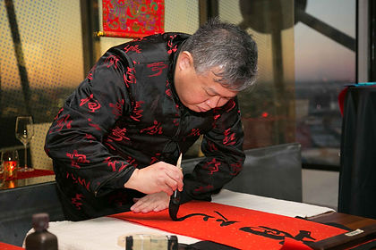 chinese-man-writing-calligraphic-letters