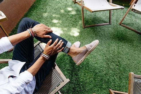 male-model-sitting-in-lawn-chair-wearing-ubuntu-espadrilles