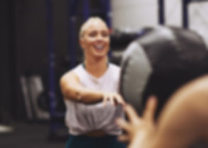 smiling-young-woman-working-out-with-per