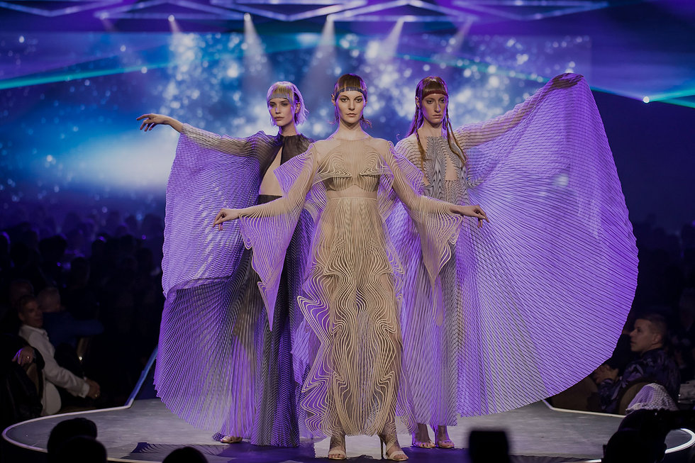 three-models-in-modern-gowns-for-diffa-d