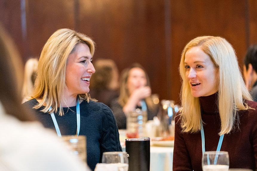 two-professional-businesswomen-talking-a