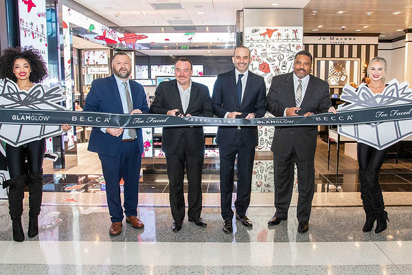 group-of-businessmen-at-ribbon-cutting-f