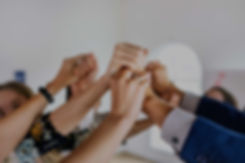 close-up-of-group-of-hands-signifying-pa