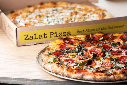 close-up-of-zalat-pizza-by-box