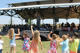 young-children-singing-with-musician-at-