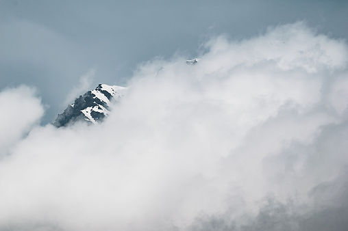 clouds-over-snowy-mountaintop.jpg