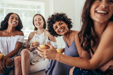 four-women-in-thirties-having-laughing-a
