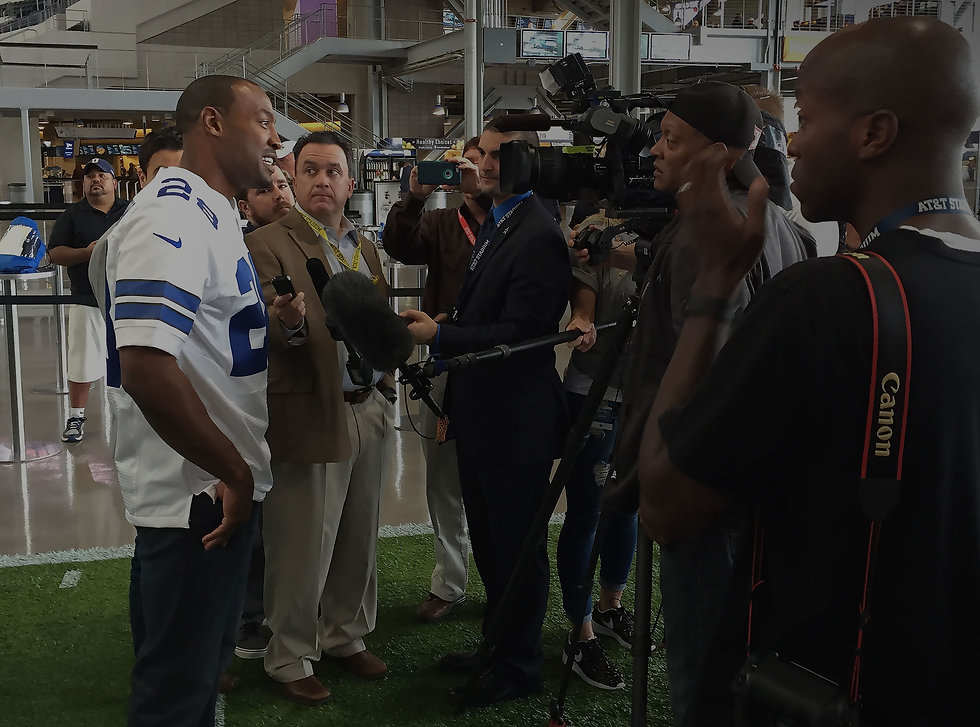 darren-woodson-speaking-to-reporters-at-