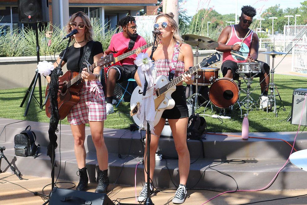two-female-music-artists-performing-a-co