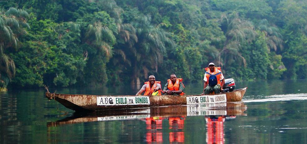 three-rescue-workers-in-boat-at-ekolo-ya