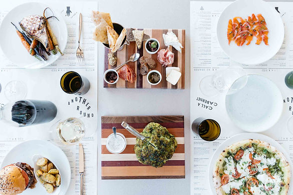 overhead-view-of-food-dishes-at-sixty-vi