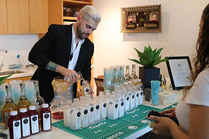 young-bartender-pouring-drinks-at-presse