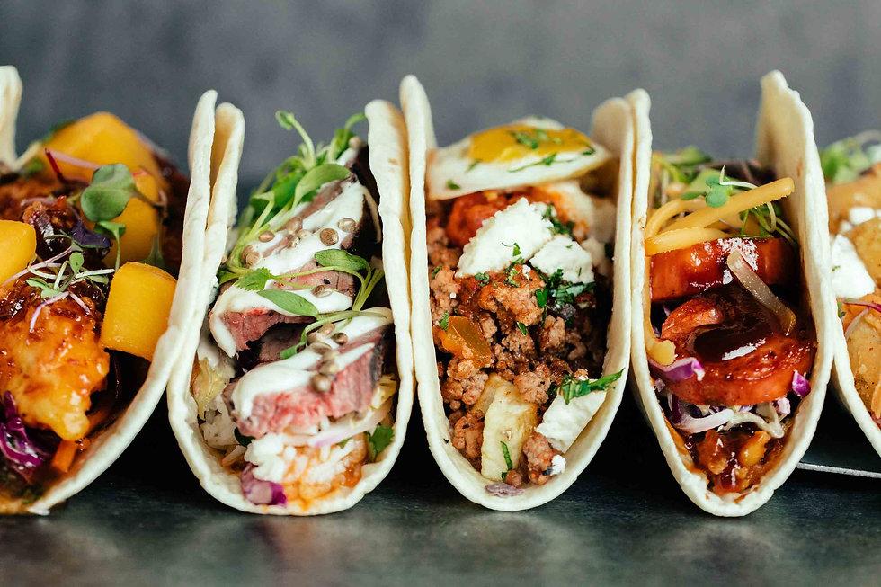 side-view-of-line-of-tacos-at-velvet-tac