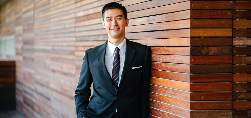 asian-businessman-with-purple-striped-ti