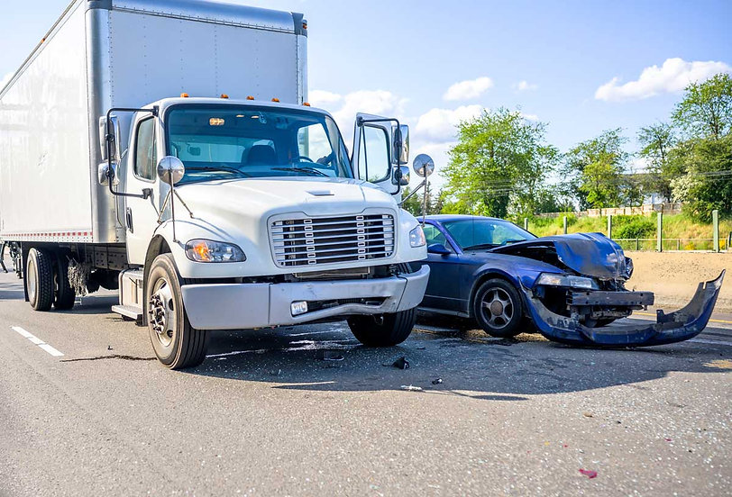 Commercial truck and car in roadway after accident