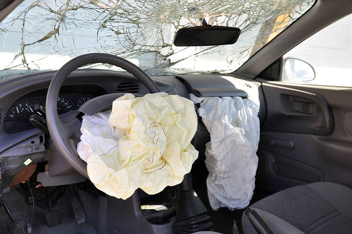 Deployed airbags in wrecked vechicle