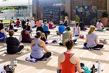 yoga-class-sitting-on-mats-at-mockinbird
