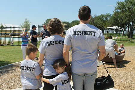 family-with-matching-resident-tshirts-at