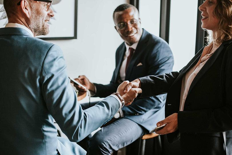three-executive-businessmen-and-women-sh