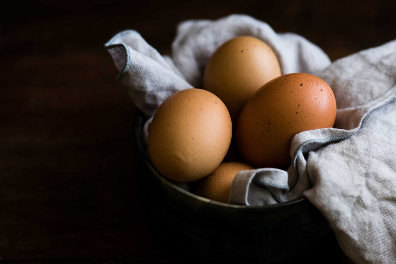 farm-fresh-brown-eggs-in-bowl-with-blue-