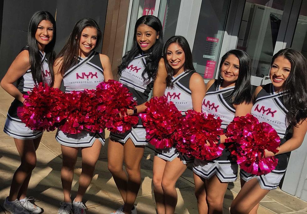 group-of-models-dressed-as-cheerleaders-