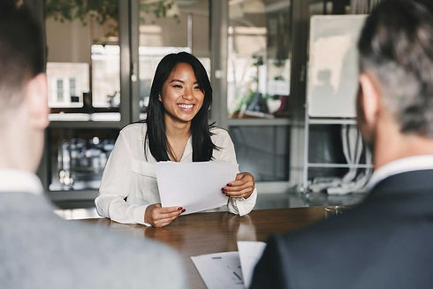 Young Asian businesswoman at meeting table