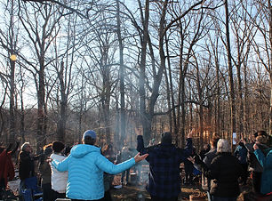 people-in-the-woods-worshipping-around-c