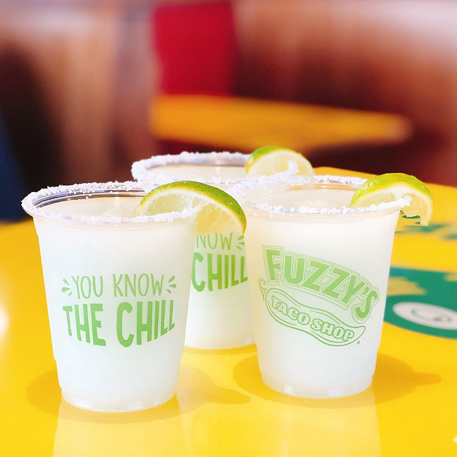 three-plastic-cups-of-margaritas-with-sa
