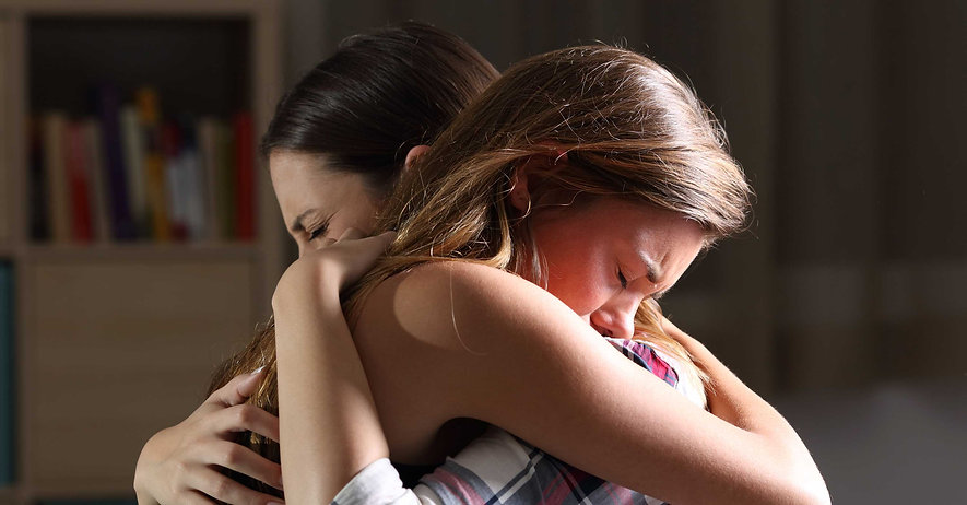 Grieving mother and daughter hugging