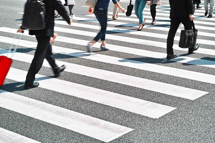 People crossing at crosswalk